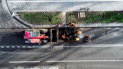 workers repair the road top view from the drone