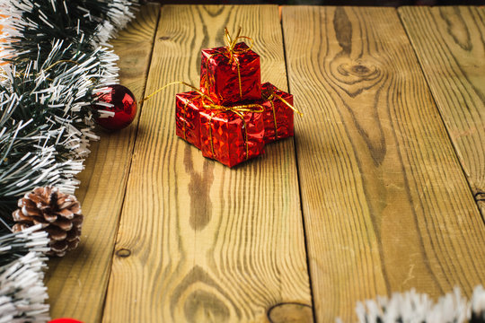 Christmas Decoration, Gifts tree branches and bells on wooden boards