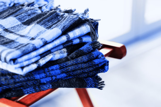 Warm plaids wool blankets on a chair