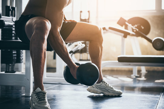 strong man exercising in the sport gym, workout exercise training in fitness for body strong and fit, healthy lifestyle people