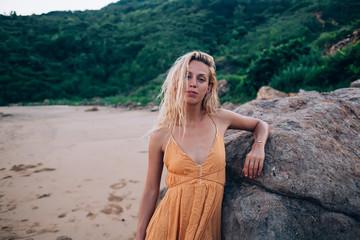 Fotobehang Calm woman in bright dress resting on beach