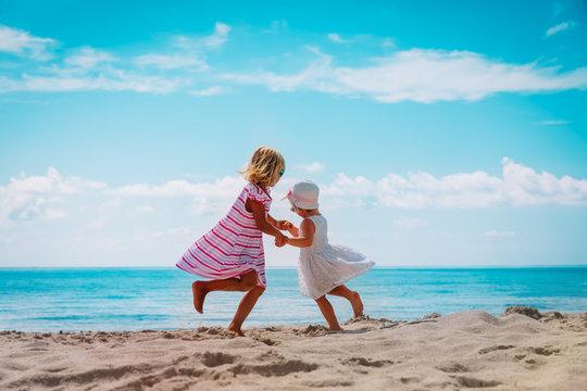 cute little girls dance at beach, family enjoy tropical vacation