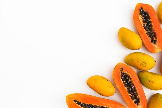 Food frame of papaya, mango fruits on white background. Flat lay