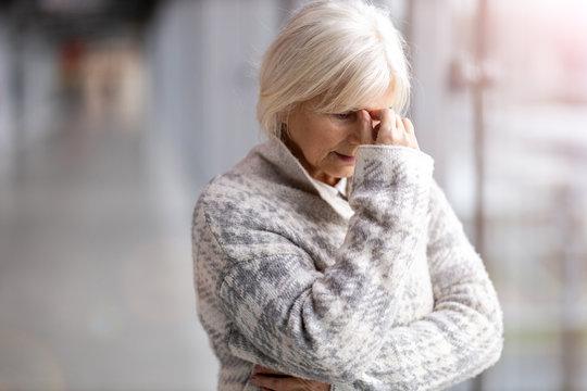 Portrait of senior woman looking depressed