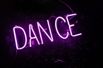Purple neon light creating the word