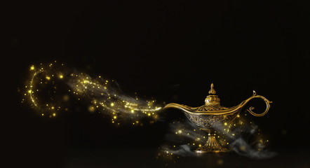 Image of magical mysterious aladdin lamp with glitter sparkle smoke over black background. Lamp of wishes