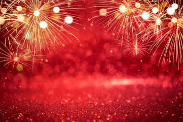 Fototapete - Red and Gold Vintage Fireworks and bokeh in Christmas and New Year copy space. Abstract background holiday.