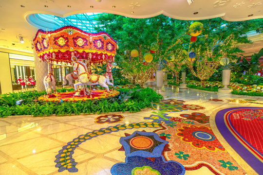 Las Vegas, Nevada, USA - August 18, 2018: animated flowers carousel in the lobby at Wynn Hotel Casino Resort, Las Vegas Strip. Preston Bailey's floral installation is made up of thousands of flowers.