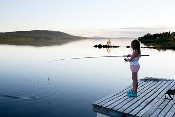 Girl fishing in lake
