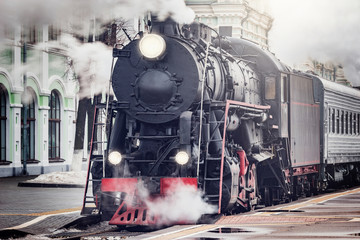 Steam train departs from the railway station. Moscow.