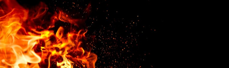 Photo sur Aluminium Feu, Flamme Fire Flame on black background. Flame border close up. Sparks from bonfire over dark night background. Christmas backdrop, wide screen