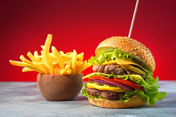 Big hamburger with double beef and french fries