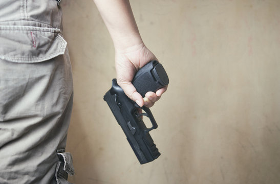 Man holding 9mm gun in hand.crime and violence.