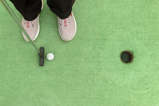 Closing a mini golf hole with the bat and ball