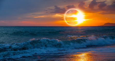 Wall Mural - Beauty sunset over the sea - Beautiful landscape with solar eclipse