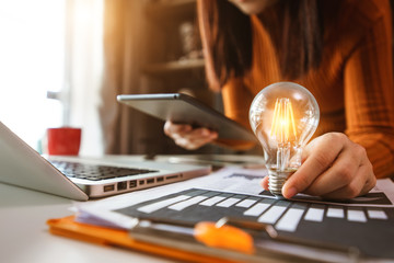 business hand showing creative business strategy with light bulb as concept Wall mural
