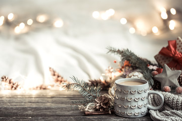 Festive background with Cup on wooden background with lights. Wall mural