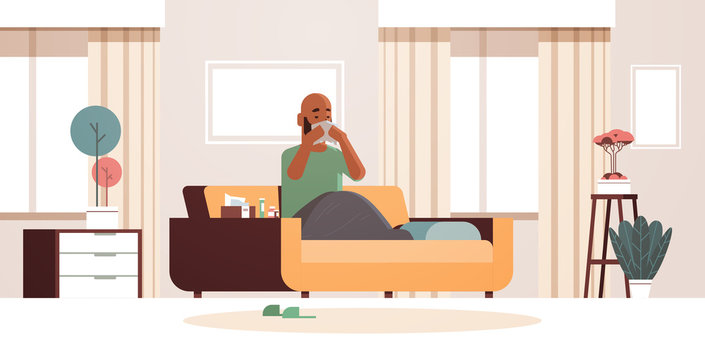 sick man blowing nose with handkerchief unhealthy african american guy cleaning snotty nose having flu sneeze sitting on sofa illness concept modern living room interior full length horizontal vector
