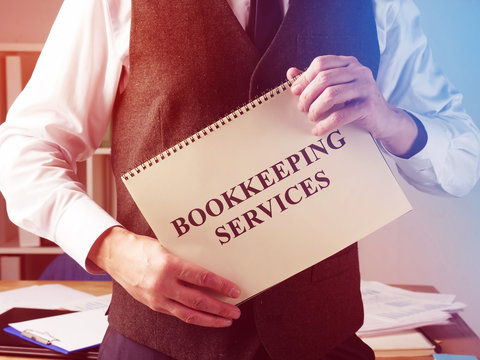 Bookkeeping services sign and accountant in the office.