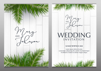 Double Wedding Invitation with palms on the white wooden background.