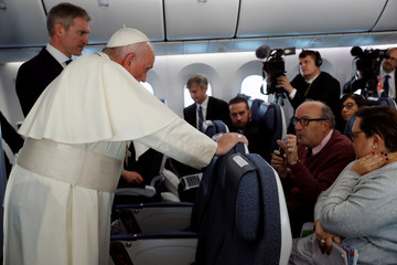 Reuters correspondent Pullella asks Pope Francis a question on the plane flying from Tokyo to Rome