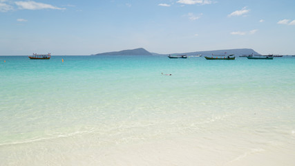 Beautiful turquoise colored ocean water at White Beach in Koh Rong Sanloem Island in Sihanoukville, Cambodia.