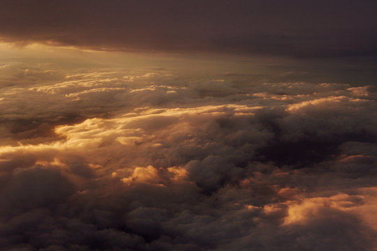 Sunset above the clouds landscape from an airplane journey