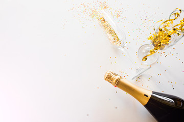 happy new year concept champagne and glasses on a white background with place for text