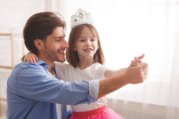 Little princess dancing tango with her dad at home