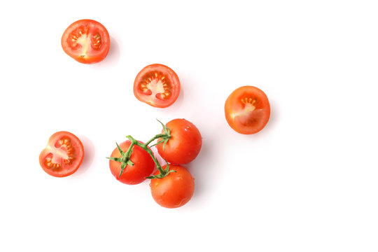 Red ripe cherry tomatoes isolated on white background. Top view