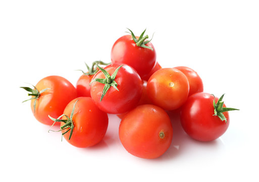 Ripe red cherry tomatos isolated on white background