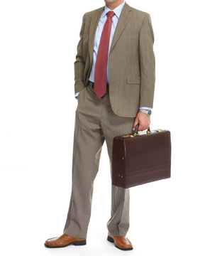 Businessman with brief case on a white background