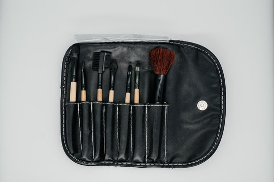 Set of makeup brushes on a light background close up