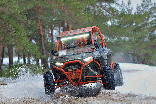 ATV and UTV driving in mud and snow at winter