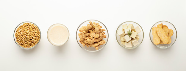 Soybeans, soy milk, soymeat, tofu and tempeh in bowls