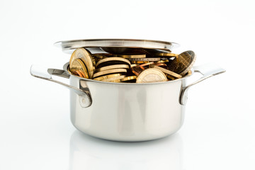 a cooking pot is well filled with euro coins, symbolic picture for subsidies