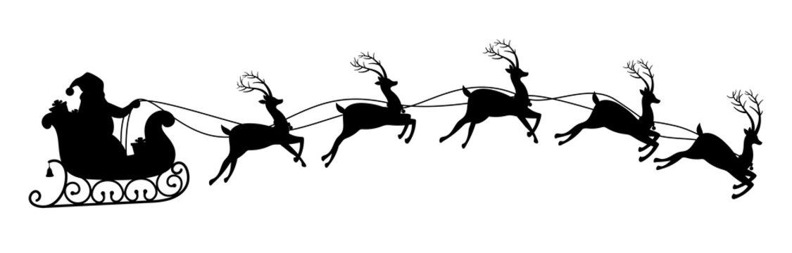 Silhouette of santa claus riding on reindeer sleigh.