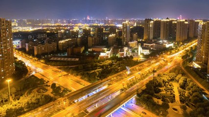 Fotomurales - time lapse of qujiang road overpass at night, xian cityscape, China