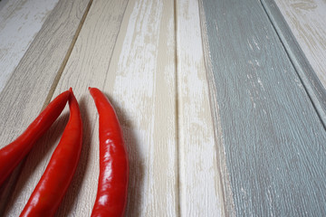Canvas Prints Hot chili peppers Image of red hot chili pepper over vintage background.