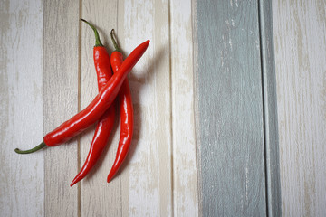 Canvas Prints Hot chili peppers Top view of red hot chili pepper over vintage background.