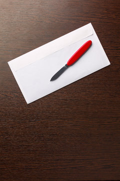 letter opener and envelope on the wood table