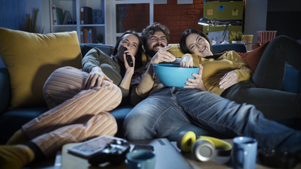 Friends watching movies together at home Wall mural