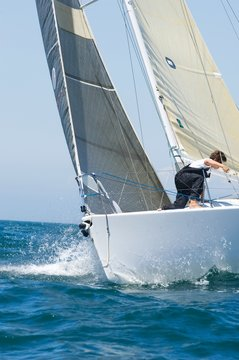 Cropped Yacht Competing In Team Sailing Event