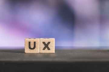 """Usability or user experience concept: Close up picture of wood cubes with the word """"ux"""""""