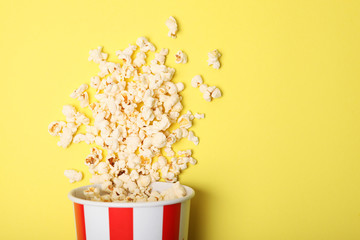 popcorn in a paper cup on a colored background