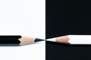 Black and a white pencils on a black and white surface - great for a cool background