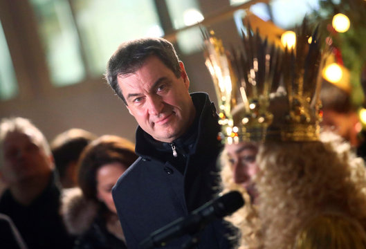 Bavarian State Prime Minister Soeder poses with Christkind (Christ Child) Benigna Munsi during a visit at the Christkindlesmarkt in Nuremberg