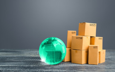 Light green globe and cardboard boxes. Economic relations commerce. Freight transportation. Distribution and trade exchange goods around the world, retail and sales. Global business, import, export. Wall mural