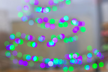 Holographic abstract background with bright and large bokeh pattern. Neon line. Festive Christmas...