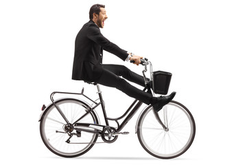 Crazy businessman riding a bicycle with legs up Fototapete